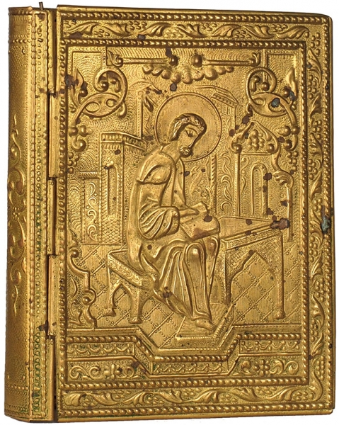Оклад желтого металла для книги сизображением евангелиста. Б.м., б.г.